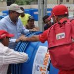 Entregamos tanques de agua a vecinos de comunidad El Minuto
